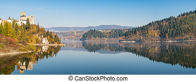 Wide stitched panorama, autumn reflection in lake, misty sunrise