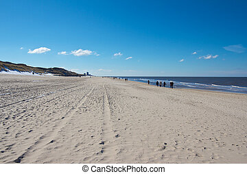 Wide Sylt Beach - Hikers walking along a wide Nort Sea beach...