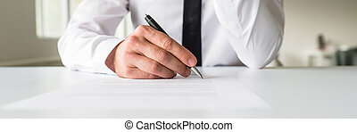 Wide view image of businessman signing a contract