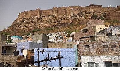 Wide view of Mehrangarh Fort above Jodhpur - Pan across the...