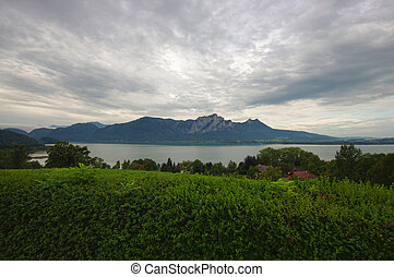 wide view of Mondsee lake in Austria, Alps in the background