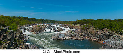 Wide view of river flowing on rocks