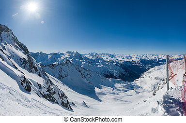 Wide view on winter alpine valley. Off-piste slope