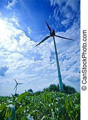 Wide wind - clean energy white wind turbine in corn field
