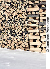 Woodshed with pieces of wood piled for winter