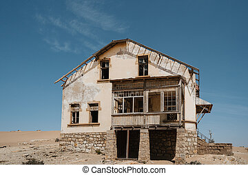 abandoned big house on a high desert plain