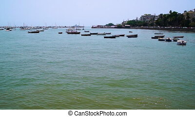 Wideshot of boats anchored in bay - A static wide shot of an...