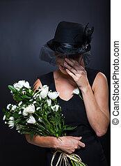 widow crying at funeral - sad widow crying at husband's...