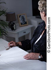 Widow looking at photograph