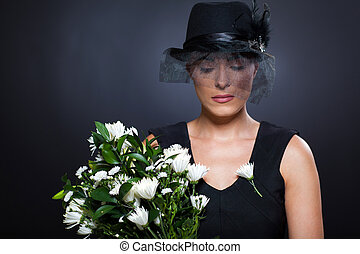 widow with flowers - sad young widow with black mourning hat...