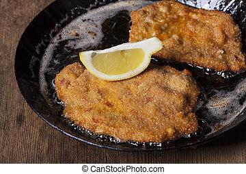 wiener schnitzel in a pan