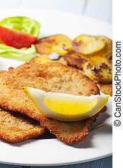 wiener schnitzel with roasted potatoes