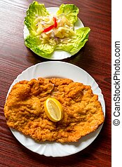 Wiener schnitzel with salad closeup