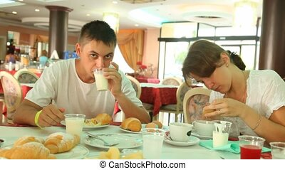 Wife and husband have their breakfast - wife and husband...