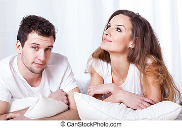 Wife and husband in bed