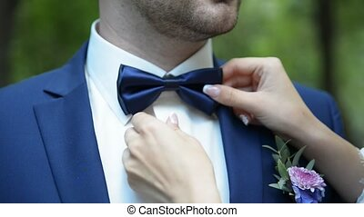 wife corrects tie to her husband