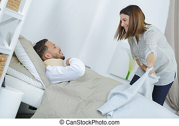 wife helping disabled husband