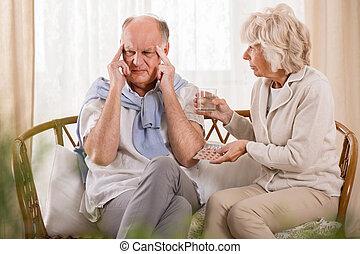 Wife helping husband with headache