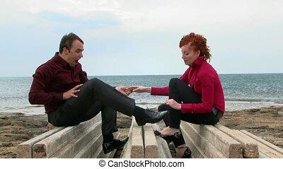 Wife helps her husband