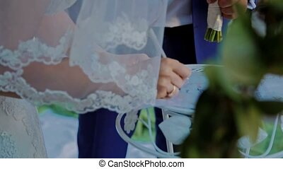 Wife puts her signature on the wedding ceremony