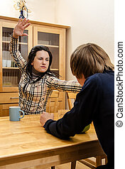 Wife quarrels with her husband in the kitchen
