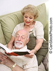 Wife Reading to Husband - A senior couple reading together. ...
