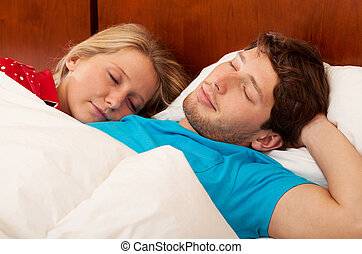 Wife sleeping next his husband