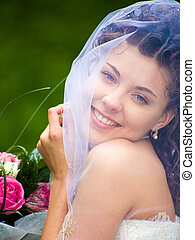 Wife - Portrait of gorgeous wife with bouquet looking at...