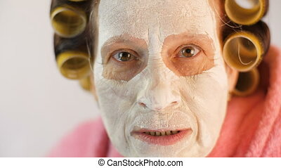 Wife swears at her husband - Wife with a mask and curlers