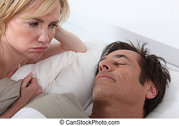Wife unhappy at husband sleeping