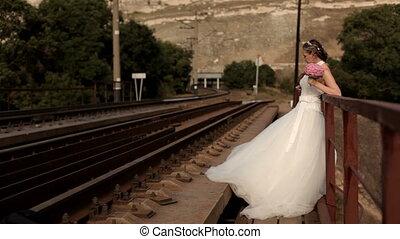 Wife waits on the rails