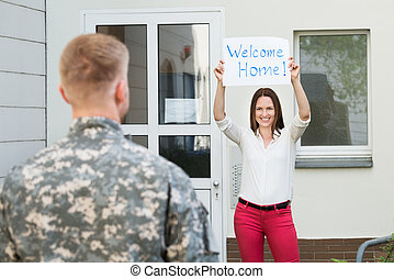 Wife Welcoming Her Husband Home - Happy Female Welcoming Her...