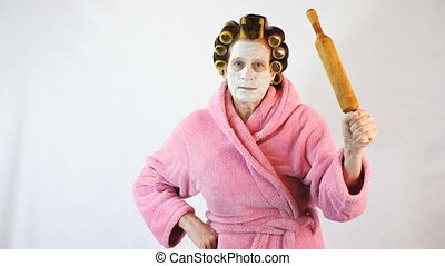 Wife with a rolling pin in hand - Wife with a mask and...