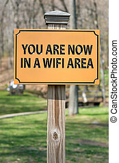 WIFI Hotspot Sign - A sign that reads YOU ARE NOW IN A WIFI...