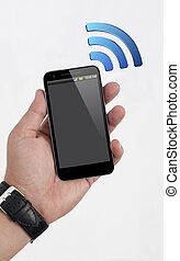 Wifi on Mobile Phone in the Human Hand - Wireless Symbol on...