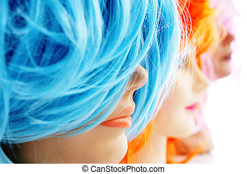 wigs of different colors - closeup of some wigs of different...