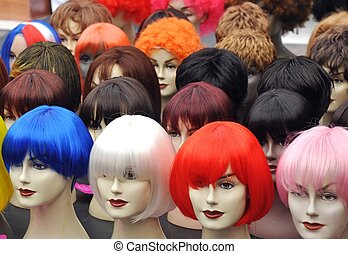 Wigs on mannequins at a street market on Amsterdam