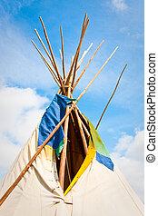 Wigwam - Top of a traditional wigwam against a bright blue...