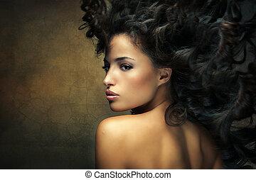 wild beauty - wild beautiful black hair woman shot with hair...