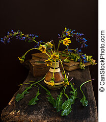 Wild blue and yellow flowers still life