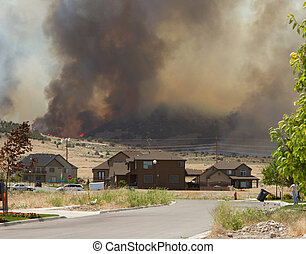 Wild fire or forrest fire endangers neighborhood