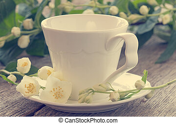 Wild flowers and cup