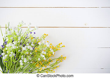 Wild flowers on old wooden background