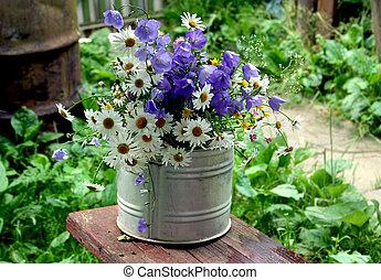 Wild flowers in a bucket