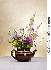 Wild flowers still life on rustic background