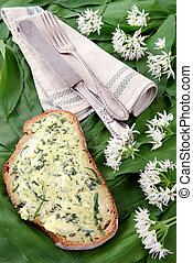 wild garlic butter on slice of bread. breakfast