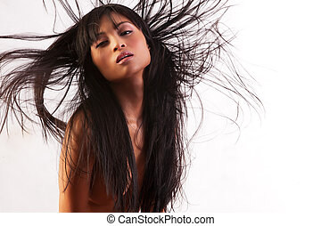 Wild hair - Beautiful brunette with hair flying around on...