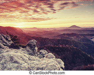 Wild hilly landscape. Early misty morning in beautiful rocks