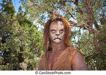 Wild Lion Man in forest - A Wild Lion man stares cautiously...