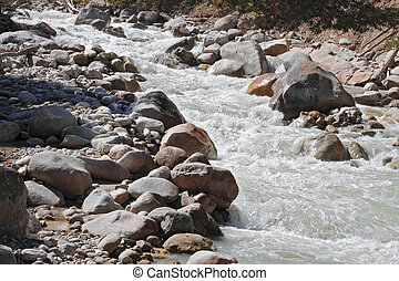 Wild mountain river flowing in the